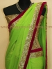 PARROT GREEN GEORGETTE SAREE WITH SEQUIN BORDER WITH PINK VELVET EDGING